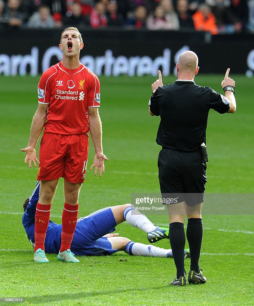 Jordan Henderson of Liverpool is spoken to by Referee Anthony Taylor during the Barclays Premier League match between Liverpool and Chelsea at Anfield on November 8, 2014 in Liverpool, England.
