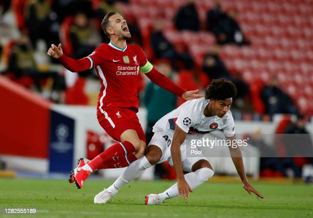 Jordan Henderson of Liverpool is tackled by JensLys Cajuste of FC Midtjylland during the UEFA Champions League Group D stage match between Liverpool...