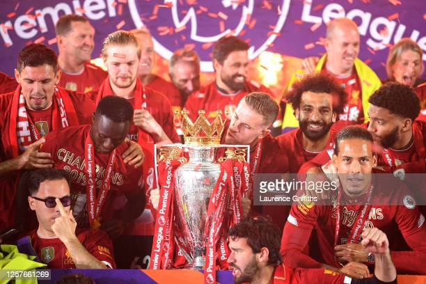 Jordan Henderson of Liverpool kisses The Premier League trophy following the Premier League match between Liverpool FC and Chelsea FC at Anfield on...