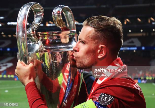 Jordan Henderson of Liverpool kisses the trophy during the UEFA Champions League Final between Tottenham Hotspur and Liverpool at Estadio Wanda...