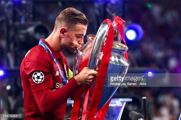Jordan Henderson of Liverpool kisses the UEFA Champions League trophy during the UEFA Champions League Final between Tottenham Hotspur and Liverpool...