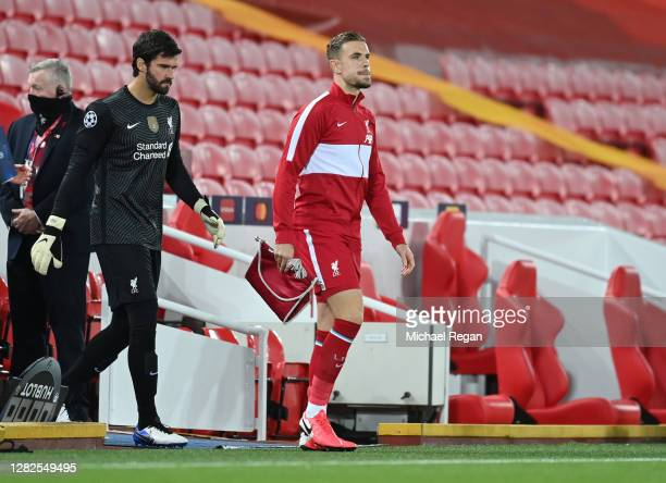 Jordan Henderson of Liverpool leads his team onto the pitch during the UEFA Champions League Group D stage match between Liverpool FC and FC...