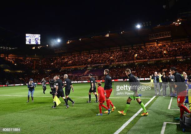 Jordan Henderson of Liverpool leads his team out at the start of the game during the Premier League match between Chelsea and Liverpool at Stamford...