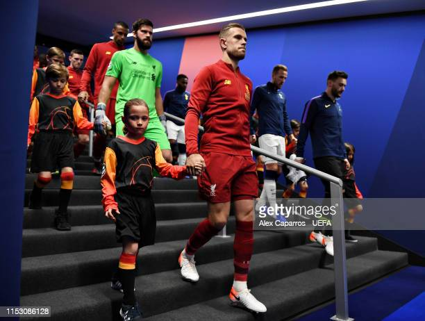 Jordan Henderson of Liverpool leads out his team prior to the UEFA Champions League Final between Tottenham Hotspur and Liverpool at Estadio Wanda...