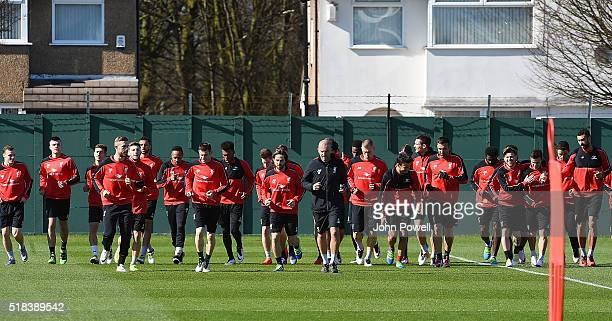 Jordan Henderson of Liverpool leads the session at Melwood Training Ground on March 31 2016 in Liverpool England