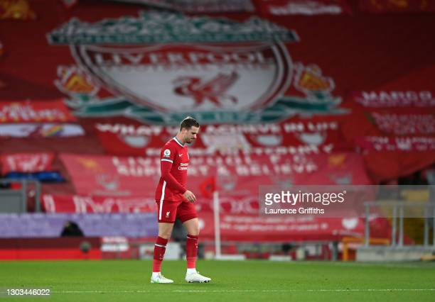Jordan Henderson of Liverpool leaves the pitch as he is substituted off due to injury during the Premier League match between Liverpool and Everton...