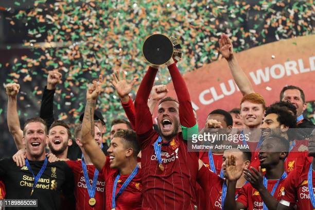 Jordan Henderson of Liverpool lifts and celebrates with the FIFA Club World Cup Trophy during the FIFA Club World Cup Qatar 2019 Final match between...