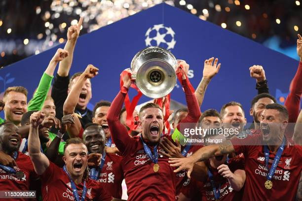 Jordan Henderson of Liverpool lifts the Champions League Trophy after after winning the UEFA Champions League Final between Tottenham Hotspur and...