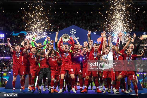 Jordan Henderson of Liverpool lifts the Champions League Trophy after winning the UEFA Champions League Final between Tottenham Hotspur and Liverpool...
