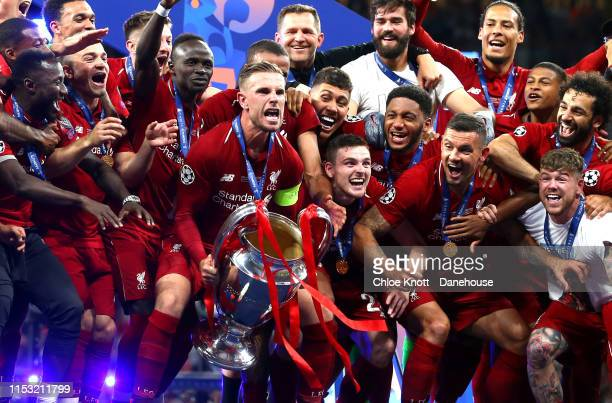 Jordan Henderson of Liverpool lifts the Champions League Trophy after his team win the UEFA Champions League Final between Tottenham Hotspur and...