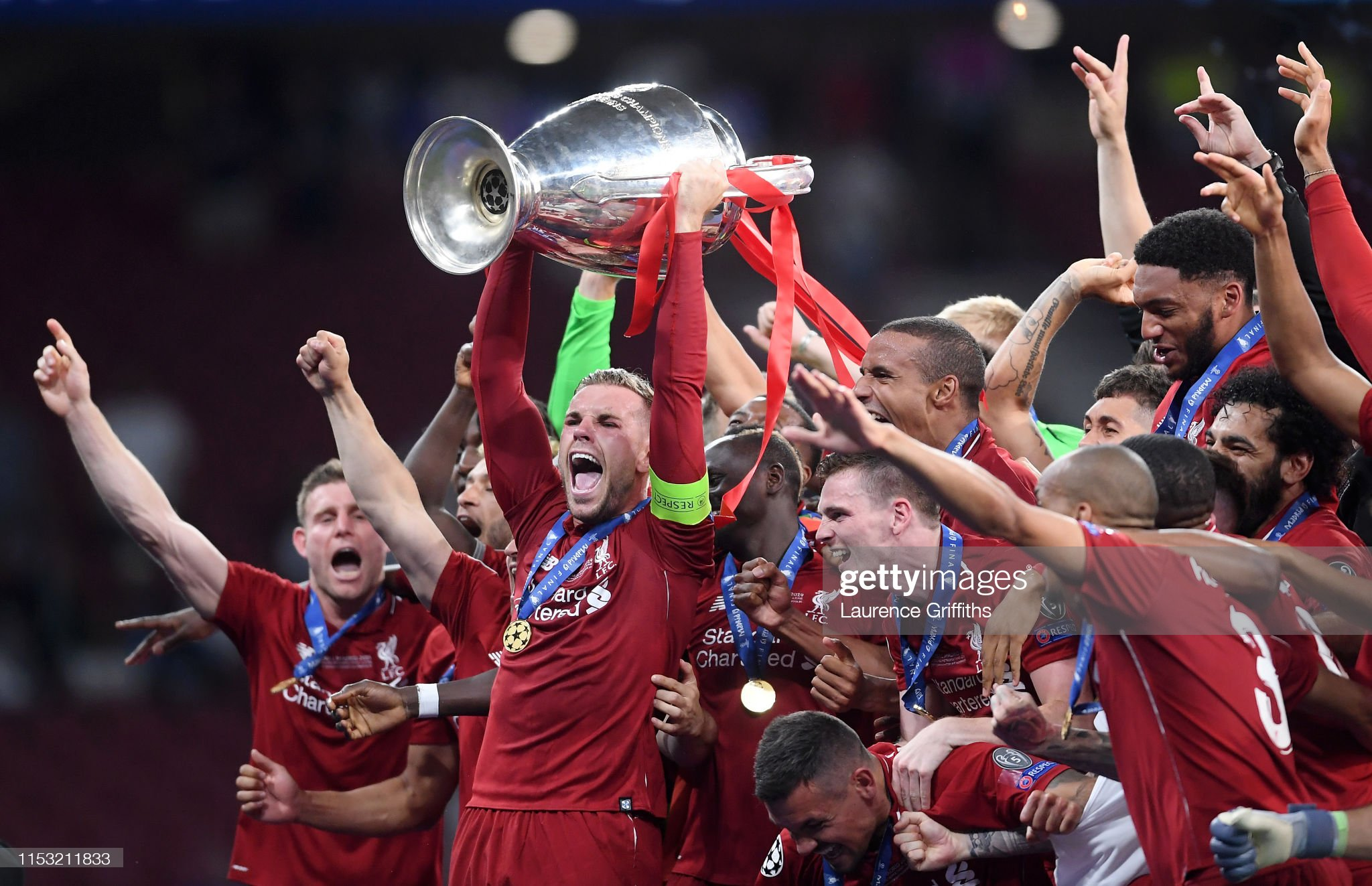 https://media.gettyimages.com/photos/jordan-henderson-of-liverpool-lifts-the-champions-league-trophy-after-picture-id1153211833?s=2048x2048