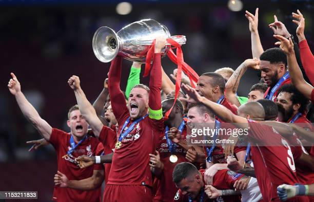 Jordan Henderson of Liverpool lifts the Champions League Trophy after winningduring the UEFA Champions League Final between Tottenham Hotspur and...