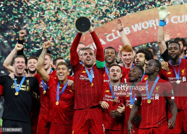 Jordan Henderson of Liverpool lifts the FIFA Club World Cup trophy following his team's victory during the FIFA Club World Cup Qatar 2019 Final...