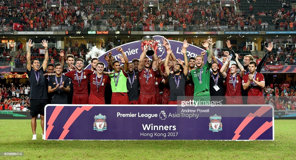 Jordan Henderson of Liverpool lifts the Premier League Asia Trophy after winning the Premier League Asia Trophy match between Liverpool FC and Leicester City FC at the Hong Kong Stadium on July 22, 2017 in Hong Kong, Hong Kong.