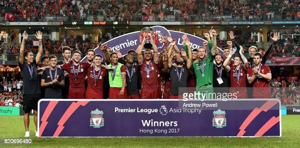 Jordan Henderson of Liverpool lifts the Premier League Asia Trophy after winning the Premier League Asia Trophy match between Liverpool FC and...