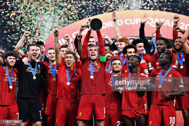 Jordan Henderson of Liverpool lifts the trophy after winning the FIFA Club World Cup 2019 final match between Liverpool FC and CR Flamengo at Khalifa...