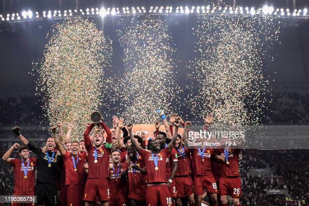 Jordan Henderson of Liverpool lifts the trophy as they celebrate victory following the FIFA Club World Cup Qatar 2019 Final match between Liverpool...