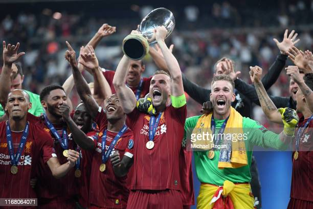 Jordan Henderson of Liverpool lifts the UEFA Super Cup trophy as Liverpool celebrate victory following the UEFA Super Cup match between Liverpool and...