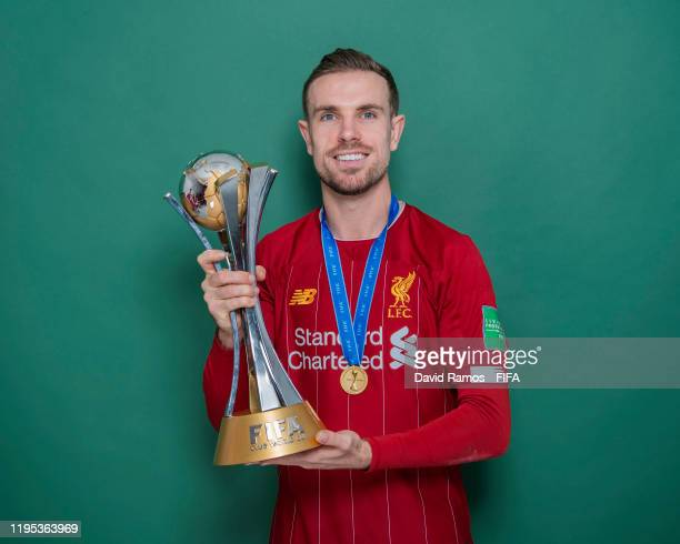 Jordan Henderson of Liverpool poses with the Club World Cup trophy after the FIFA Club World Cup Qatar 2019 Final match between Liverpool and CR...