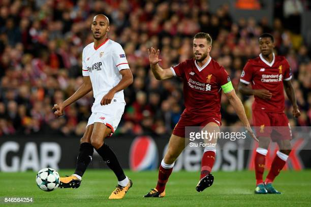 Jordan Henderson of Liverpool puts pressure on Steven N'Zonzi of Sevilla during the UEFA Champions League group E match between Liverpool FC and...