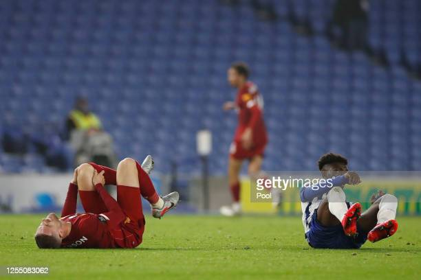 Jordan Henderson of Liverpool reacts after sustaining an injury during the Premier League match between Brighton Hove Albion and Liverpool FC at...