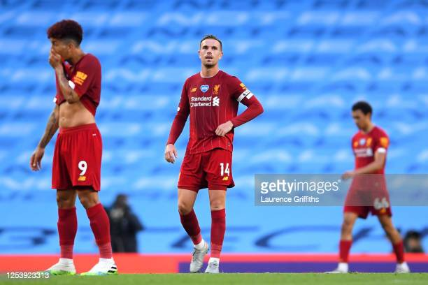 Jordan Henderson of Liverpool reacts to Manchester City scoring there third goal during the Premier League match between Manchester City and...