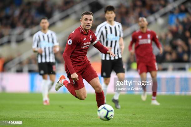 Jordan Henderson of Liverpool runs with the ball during the Premier League match between Newcastle United and Liverpool FC at St James Park on May 04...