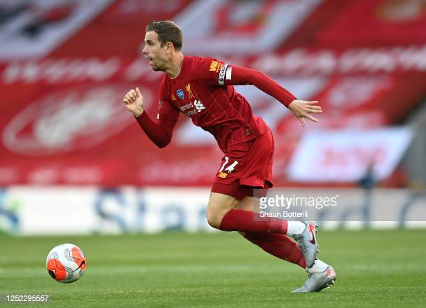 Jordan Henderson of Liverpool runs with the ball during the Premier League match between Liverpool FC and Crystal Palace at Anfield on June 24 2020...