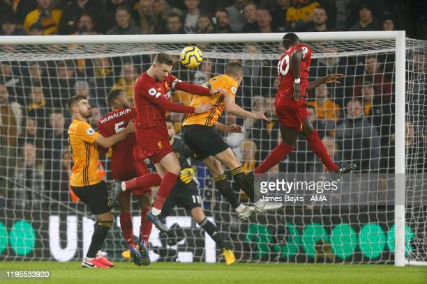 Jordan Henderson of Liverpool scores a goal to make it 0-1 during the Premier League match between Wolverhampton Wanderers and Liverpool FC at...