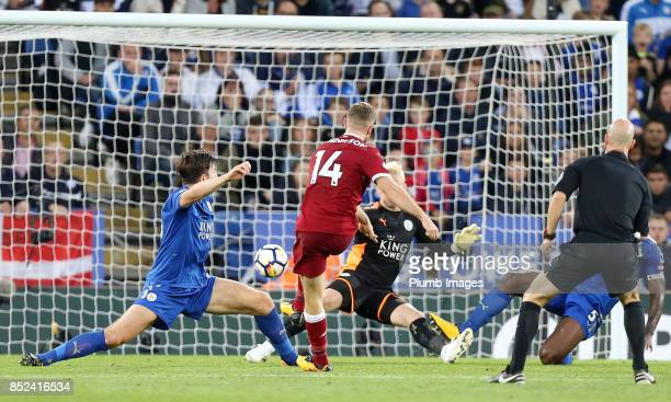Jordan Henderson of Liverpool scores past Kasper Schmeichel of Leicester City during the Premier League match between Leicester City and Liverpool at...