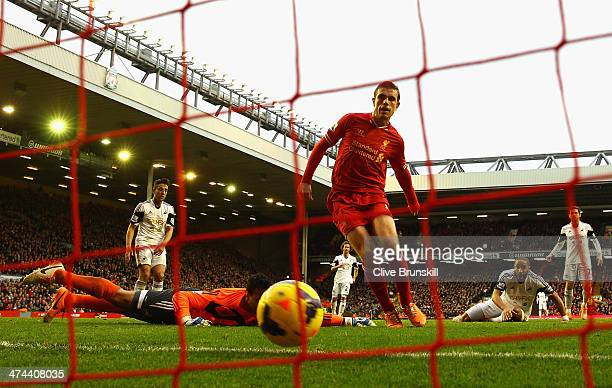 Jordan Henderson of Liverpool scores the winning goal during the Barclays Premier League match between Liverpool and Swansea City at Anfield on...