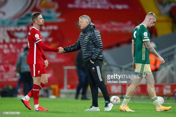 Jordan Henderson of Liverpool shakes hands with Chris Wilder Manager of Sheffield United following the Premier League match between Liverpool and...
