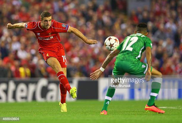 Jordan Henderson of Liverpool shoots past Anicet Abel of PFC Ludogorets Razgrad during the UEFA Champions League Group B match between Liverpool FC...