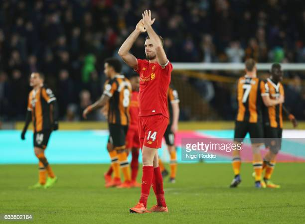 Jordan Henderson of Liverpool shows appreciation to the fans after the Premier League match between Hull City and Liverpool at KCOM Stadium on...