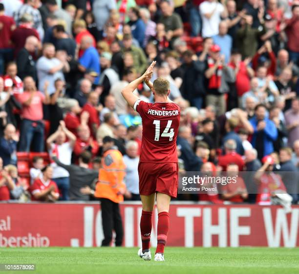 Jordan Henderson of Liverpool shows his appreciation to the fans at the end of the Premier League match between Liverpool FC and West Ham United at...