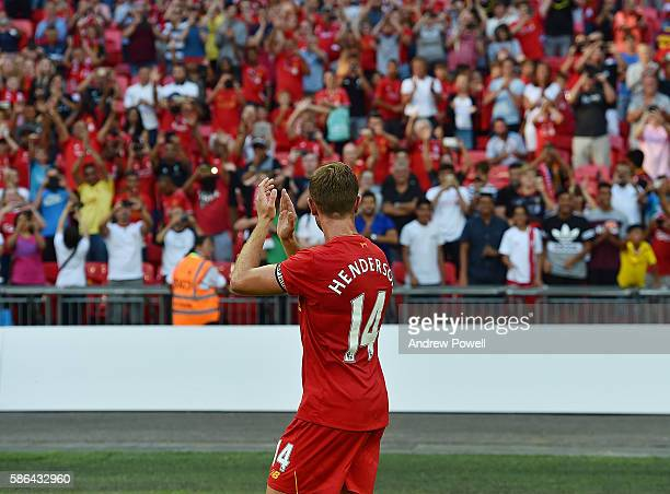 Jordan Henderson of Liverpool shows his appreciation to the fans at the end of the International Champions Cup match between Liverpool and Barcelona...