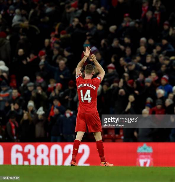 Jordan Henderson of Liverpool shows his appreciation to the fans at the end of the Premier League match between Liverpool and Tottenham Hotspur at...