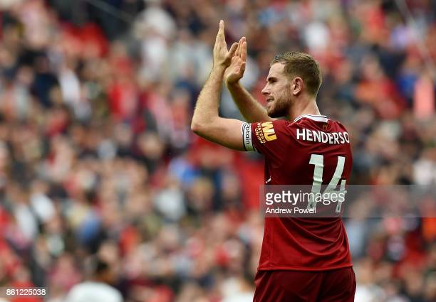 Jordan Henderson of Liverpool shows his appreciation to the fans at the end of the Premier League match between Liverpool and Manchester United at...