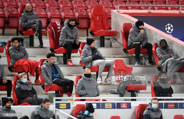 Jordan Henderson of Liverpool sits on the docially distanced bench during the UEFA Champions League Group D stage match between Liverpool FC and FC...