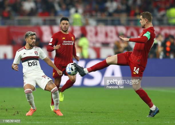 Jordan Henderson of Liverpool stretches for the ball ahead of Giorgian De Arrascaeta of CR Flamengo during the FIFA Club World Cup Qatar 2019 Final...