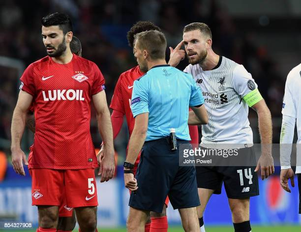 Jordan Henderson of Liverpool talks to Clement Turpin referee during the UEFA Champions League group E match between Spartak Moskva and Liverpool FC...