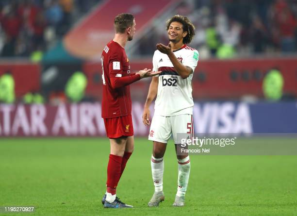 Jordan Henderson of Liverpool talks to Willian Arao of CR Flamengo during the FIFA Club World Cup Qatar 2019 Final between Liverpool FC and CR...
