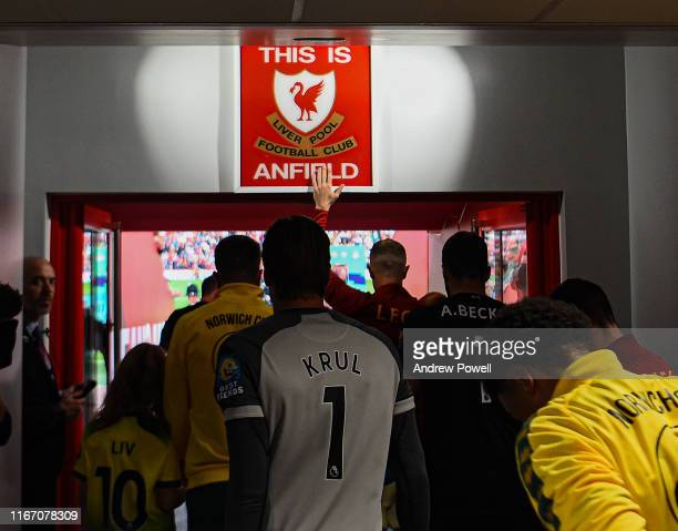 """Jordan Henderson of Liverpool touching the """"This is Anfield"""" sign before the Premier League match between Liverpool FC and Norwich City at Anfield on..."""