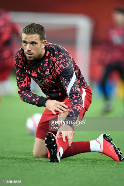 Jordan Henderson of Liverpool warms up ahead of the UEFA Champions League Group D stage match between Liverpool FC and FC Midtjylland at Anfield on...