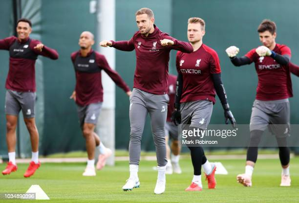 Jordan Henderson of Liverpool warms up during a Liverpool training session at Melwood Training Ground on September 17 2018 in Liverpool England