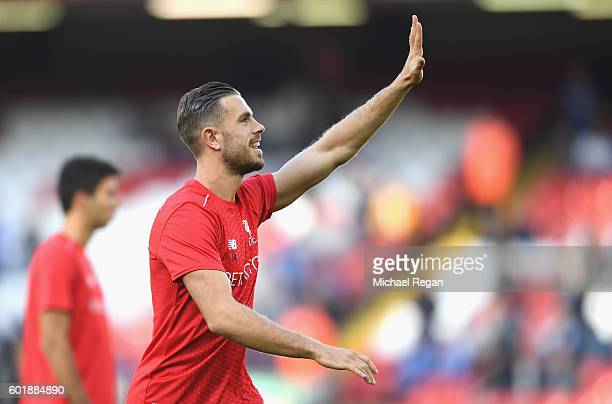 Jordan Henderson of Liverpool waves to fans during the warm up during the Premier League match between Liverpool and Leicester City at Anfield on...