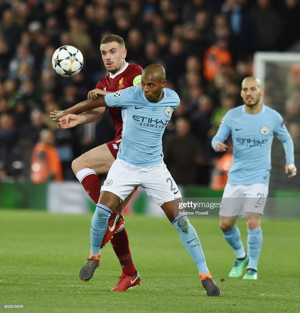 Jordan Henderson of Liverpool with Fernandinho of Manchester city during the UEFA Champions League Quarter Final Leg One match between Liverpool and Manchester City at Anfield on April 4, 2018 in Liverpool, England.