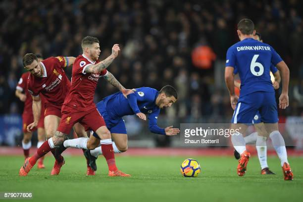 Jordan Henderson of Liverpooll and Alberto Moreno of Liverpool foul Eden Hazard of Chelsea during the Premier League match between Liverpool and...