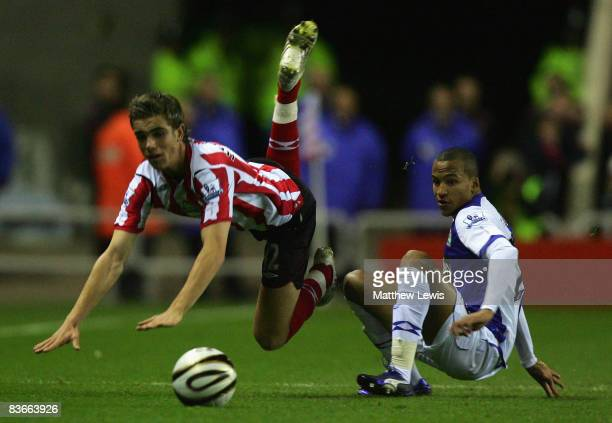 Jordan Henderson of Sunderland is brought down by Martin Olsson of Blackburn Rovers during the Carling Cup Fourth Round match between Sunderland and...