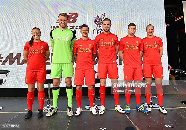 Jordan Henderson Philippe Coutinho Jon Flanagan and Simon Mignolet of Liverpool and Gemma Bonner and Natasha Harding of Liverpool Ladies during the...
